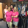 Volunteers at the MISD Clothes Closet representing Breast Cancer