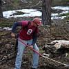 Ted Rummel wielding a spade.