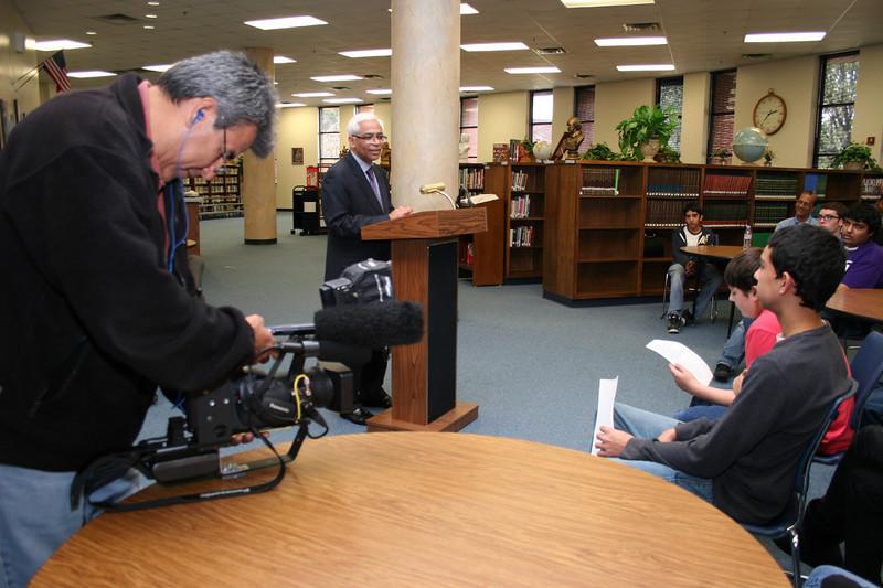 Newscrews film the event.