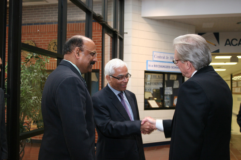 Members of the Consul General meet the district Superintendent.