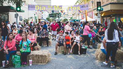 Festival goers sit on small hay bales provided as seating for the main stage area during the Dia De Los Muertos festival. Saturday October 29, 2016 in downtown Corpus Christi, Tx.