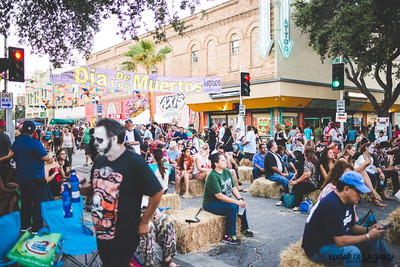 Festival goers pass the main stage area on Starr and N. Chaparral st. during the Dia De Los Muertos festival in downtown Corpus Christi, Tx. Saturday October 29, 2016.