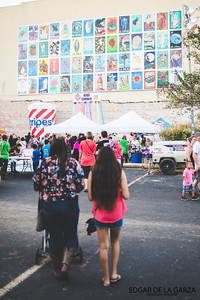 The Loteria Mural can be seen above as Families make their way to the kids corner section of the Dia De Los Muertos festival in downtown Corpus Christi, Tx. Saturday October 29, 2016.