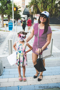 Monica Silva and her daughter pose for a photo as they depart from the Dia De Los Muertos festival. Saturday October 29, 2016 in downtown Corpus Christi.