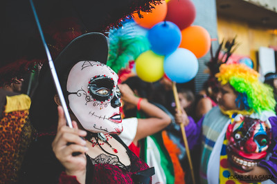 A group of performers pause for photos outside of the Ritz Theatre. Saturday October 29, 2016 during the Dia De Los Muertos festival in downtown Corpus Christi, Tx.
