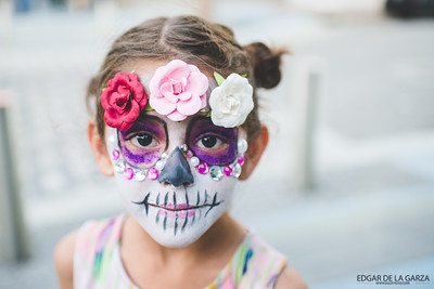 Monica Silva's daughter poses for a photo with her face painting received at the Dia De Los Muertos festival. Saturday October 29, 2016 in downtown Corpus Christi.