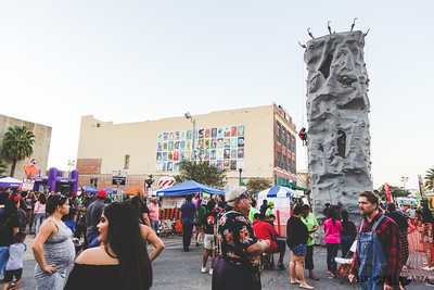 A rock climbing wall set up in the middle of N. Chaparral st. as part of the family entertrainment during the Dia De Los Muertos Festival. Saturday October 29, 2016 in downtown Corpus Christi, Tx.