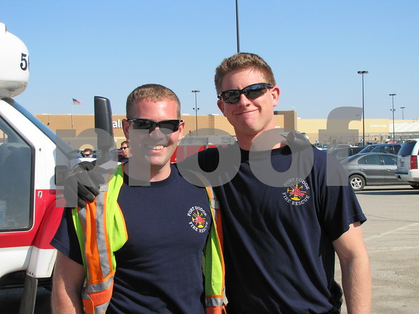 Firemen Tom Ubben and Eric Conell were volunteering their services to help pick up litter and debris.