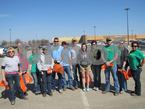 A team of Cargill employees led by Alan Viaene (in center with hat) showed up to help beautify the retail area of Fort Dodge.