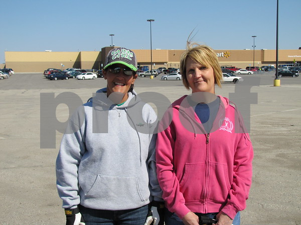 TJ Murray and Lori Summers volunteered on this sunny afternoon.