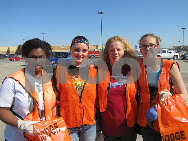 Essence Clayton, Brittany Foreman, Kelly Bradley, and MacKenzie Steberg-Kaloupek volunteered as a team from the Lighthouse Ministry to pick up litter and debris for the FOD walk organized by the Image Committee of the Greater Fort Dodge Growth Alliance.
