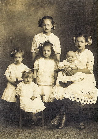 Daughters of Thomas and Esther (Schock) Brobst.  Standing in back: Sadie (later Bachert). Middle row (L-R): Melva (later Hill), Maimie (later Seaman), baby Elsie (later Schwenk), Esther (later Bachert). In chair: Agnes (later Hill).