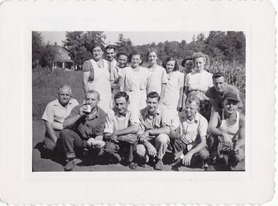 Worker's at Joe Gilardone's factory.  Front, L - R: 6) Carl Heist. Joe Gilardone Jr (leaning).  Back, L - R: 1) Stella Trexler, 2) Leon Hoppes, 3) Agnes Hill, 4) Esther Moyer, 5) Kathryn Haag, 6) Melva Hill, 8) Rachel (Wisser) Miller.
