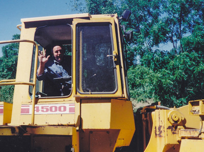 John M. Hill in his beloved payloader.