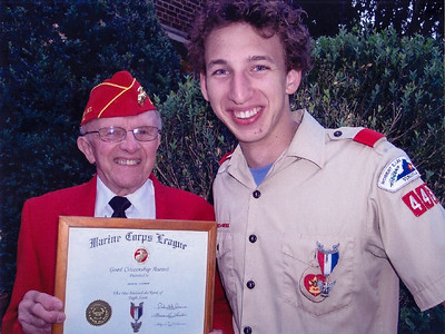 Every year Harold Derr hands out the Eagle Scouts awards. Here he proudly honors his grandson, Jason Lippman. (17 years old, 2004).