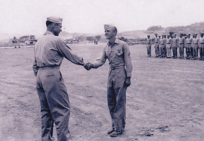 Harold Derr receiving the Air Medal, in Okinawa, Japan, in 1945.