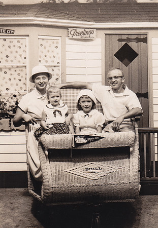 Esther (Hill) & Harold Derr on boardwalk in Atlantic City, NJ. with daughters Dorian (age 6) and Lisa (age 2), 1959.