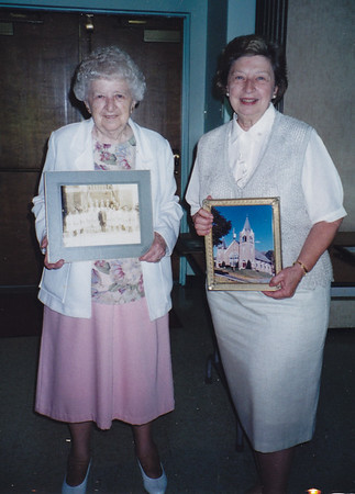 Ellen (Hill) Heffner, with her sister Esther (Hill) Derr. Ellie holding up her confirmation picture at a confirmation reunion for Zion's Church.
