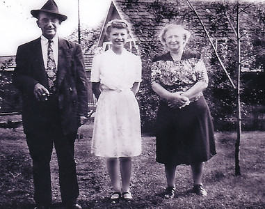 Milton J. and Gertrude (Strausser) Hill with their daughter Esther (later Derr), in their back yard. Likely around 1944, when Esther was around 17 years old. She says she never drove because her father said he would take her anywhere she ever wanted to go - and he did. He was always happy to drive anyone anywhere - but drove extremely slow.