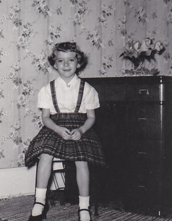 Nov 1958. Dorian Derr sitting in Granny's livingroom.