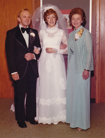 Harold and Esther with their oldest daughter Dorian at her wedding.