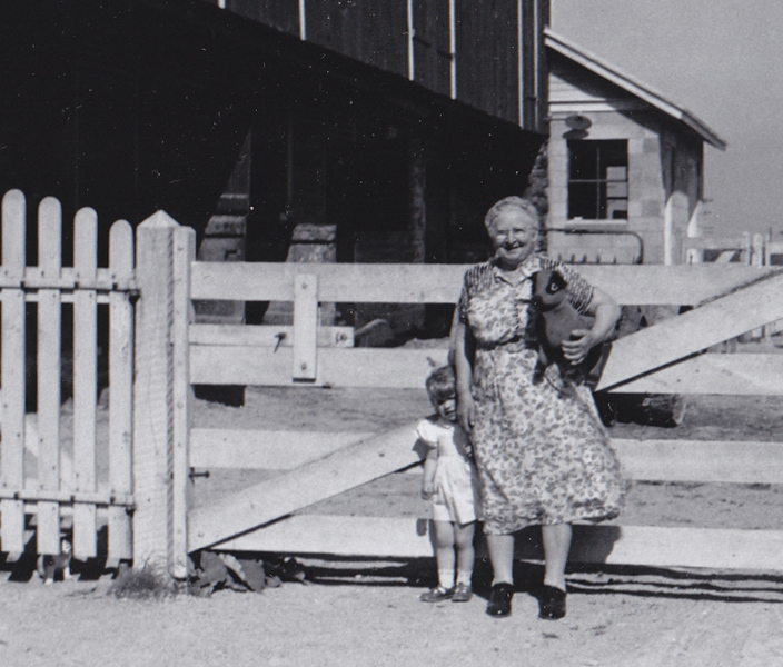 Gertrude (Strausser) Hill with her grand-daughter Dorrian Derr, at Milton and Gertrude's barn on the Hill homestead.