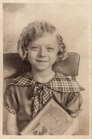 Esther Hill (later Derr), 7 years old, in 2nd grade, around 1934. Her sister Ellen Hill (later Heffner), curled her hair with a crimping iron. Esther says Ellen curled everyone's hair.