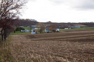 Homes: 1) Fore-left (white) was the home of Pharis Fry married to Mabel Heffner. 2) Fore-right (green) Shappell. 3) back (blue and green) buildings of John M. Hill owner of JMH Trailers. HIs house over the hill out of view. - All on land originally part of the Hill homestead.