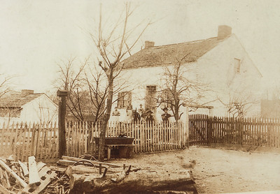 The Hill Homestead. Milt and Gurt were married in 1910. They added the porch some time after they were married, dating this image to be around 1910-20. (The porch was remodeled in the 1950's by John L. Hill with his style of wooden railings). L-R: 'Cass' Catherine Berstler (buried at Zion Moselem Church above Virginville, PA), 'Granny' Gertrude (Strausser) Hill, Morris Dries (boy with St. Bernard dogs), Grampy's (Milton's) father John M. HIll (b. 1855), and 'uncle John' John T. Hill (b. 1893).