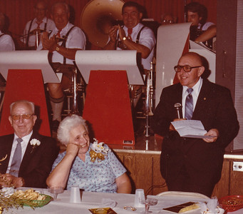 50th anniversary for Jacob and Agnes (Brobst) Hill, in 1983. To their right is son William 'Billy' Hill. Polka band behind them.