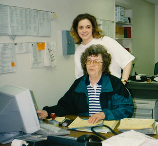 Mary (Hill) Grim worked for her brother John at JMH Trailers for several decades, here seen with her grand-daughter Angela Grim (later Wolf), for on the job secretarial training.