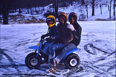 The pond of John and Marie (Schrack) Hill, was always a great source of fun, whether winter or summer. L-R: ____ (? driving), Jesse J Hill and cousin Todd Billig, on a 3 wheeler.