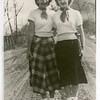 Mary Hill (Grim) and Mabel Heffner (Fry).  Taken around 1950 on dirt road at Stanley & Ellen (Hill) Heffner's place. (Now Farview Rd.).