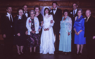 The wedding of Jeb and Beth (Hill) Humma with parents and grandparents. Jan 1981. Bride's family at left: Wayne and Vera (Naftzinger) Schrack, Melva (Brobst) Hill (front, white sweater), John and Marie (Schrack) Hill (behind Melva). Groom's family at right: Ronald and Marian (Werner) Humma, Grace (Meinholz Maurer) Werner, Claude Werner.