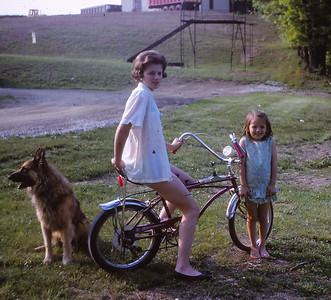 Marie (Schrack) Hill with daughter Beth A. Hill (later Humma) and dog Dutch, at their home.