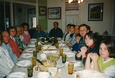 Wayne and Vera Schrack invited the extended Hill family for a meal. L-R: Lois and John Ford, Marie (Schrack) Hill (red), _____, _____,  Margaret and Sterling Rothrock, Bart Hill, Debra (Rothrock) Hill, John S. Hill, John M. Hill, James B Hill, Jesse J Hill, Lori (Ford) Hill, Megan Hill. Jeb and Beth (Hill) Humma, Wayne and Vera and Norman, at foot end out of view.
