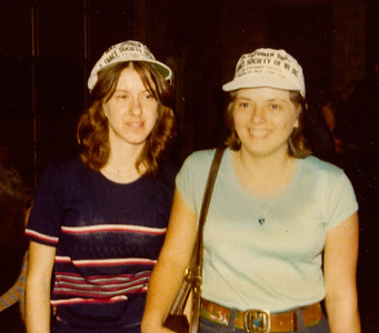 Lori Grim (later Moyer) and cousin Beth Hill (later Humma) at a Hoe Down in John M. Hill's shop. They have hats on from WT Society.