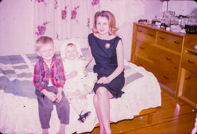 Marie (Schrack) Hill, in her bedroom with children Bart W and Beth A Hill (later Humma), 1964(?)