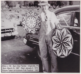 Milton Hill in front of his car, showing 'hex' signs that he painted. Photo taken at Kutztown Folk Festival, 1960.