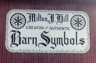 """Milton J. Hill, creator of Authentic Barn Symbols"". This is the sign he took each year to the Kutztown Folk Festival. Ethel Smith offered to paint it for him."