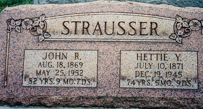 Tombstone of John R. and Hettie Y. Strausser.