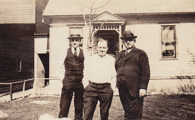 Back says 'Howard Bechtel'. Which is Howard? and who are the others? Where are they?