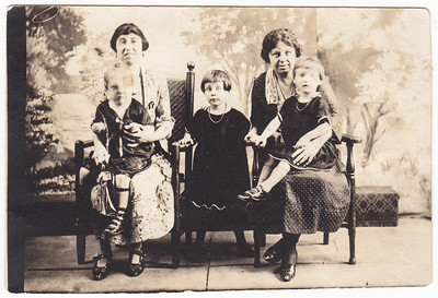Mary (Humma) House holding her daughter Evelyn House (later wife of Hank Nice?), Verna Grace Humma (later Johnston), Ida Estella 'Stella' (Wien) Humma holding Ruth Elizabeth Humma (later Fisher). At the time of this image, Mary and her husband were separated for a time. She and her children temporarily lived in her brother Bill's house in Reading, the husband/father continued to live and work in Fairmont Park  Germantown, PA.