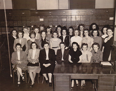 Ann (Humma) Huber, Bell Telephone, Frackville, PA, office. She is center of desk, last row, also centered under the right hand wall panel.