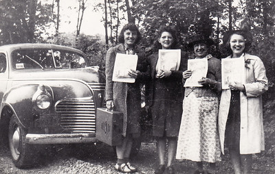 Mildred Strouse, 2nd from left. With her preaching partners, holding up the Watchtower. Notice also the player.