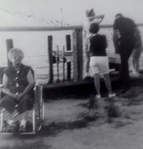 Stella (Wien) Humma (wheel chair) after her stroke. Marian (Werner) Humma (back turned, white shorts), and other family. Stone Harbor, NJ (?).
