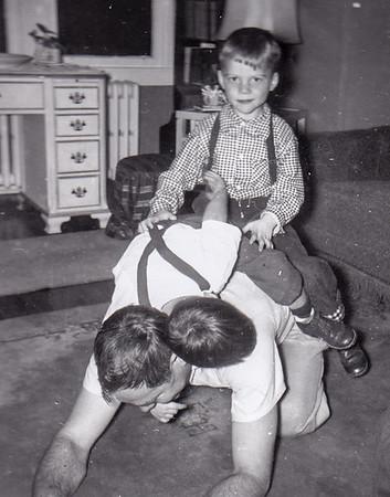 Robert Humma with nephew David Huber (sitting upright) and Bruce Fisher, Nov 1954.