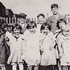 Eisenbrown St., Reading, PA. <br /> The tall boy in the back is Robert Joseph Humma (born circa 1910). <br /> The back of photo lists the following names: <br /> The Humma's: Robert, Raymond, Warren, Ruth, and Verna, and also Eleanor Vollmer, Evelyn House, Billy Cummings.<br /> Can anyone identify who is who along with the two missing names?