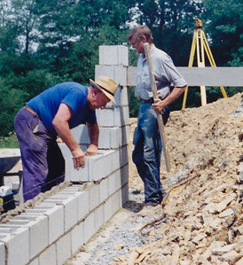 John M. Hill (straw hat), Jeb A. Humma (holding level), laying block basement for Jeb Humma's house (Farview Rd. Hamburg).