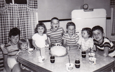 L-R: Bud, Karen Humma,  Shiela Humma, Gary Humma, Mikey Humma, Donny and Conrath. (Humma children with cousins on Bausher side). July 1950